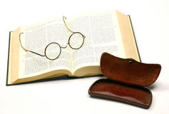 Open bible with a pair of glasses. And a case Stock Image