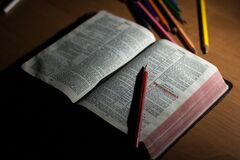 Open Bible with red pencil Stock Photos