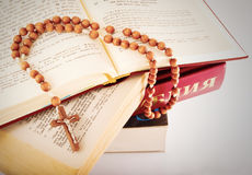 Open Bible and rosary Stock Photo