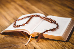 Open bible with rosary beads Stock Image