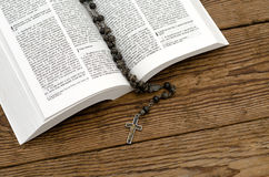 Open Bible with rosary Stock Images