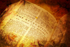 Open Bible showing The Revelation royalty free stock photography