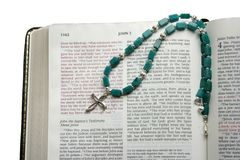 Open Bible with silver cross Stock Photography