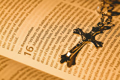 Open bible and silver crucifix Royalty Free Stock Image