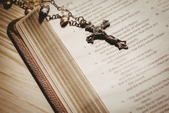 Open bible and silver crucifix Royalty Free Stock Images