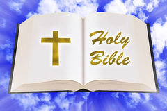 Open Bible on The Sky. Open Bible on blue sky background with gold text Stock Photo