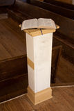 Open Bible on Slender Podium. In country church Royalty Free Stock Images