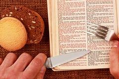 Open bible spiritual bread food Royalty Free Stock Photos