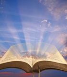 Open bible spiritual light. Photo of open bible with sun rays shining through pages depicting spiritual light Stock Photos