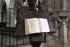 An open bible on a stand in the shape of an eagle