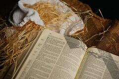 Open bible on straw