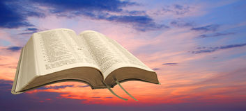 Open bible sunset sky