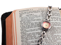 Open Bible and watch, silver Royalty Free Stock Image
