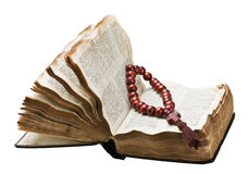 Open bible and wooden rosary. Isolated on white background Royalty Free Stock Image