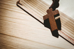 Open bible and wooden rosary beads Stock Photo