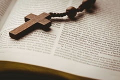 Open bible and wooden rosary beads Stock Photography