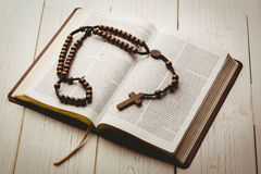 Open bible and wooden rosary beads Royalty Free Stock Photo