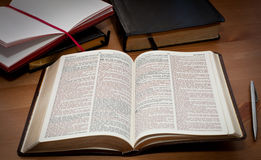 Open bible. On the wooden table royalty free stock photos