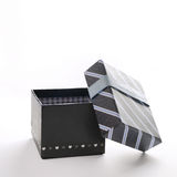 Open black gift box with blue ribbon and blue lines Royalty Free Stock Photography