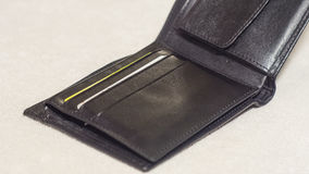 Open black leather wallet on a light background Royalty Free Stock Photos