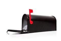 An open black mailbox with letters on white Royalty Free Stock Image