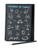 Open black notebook on white background with doodle icon relate. With Internet of Things (IOT) , Technology concept Stock Photo