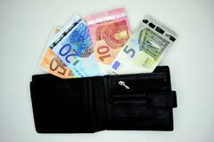 Open black wallet with euro banknotes Stock Photo