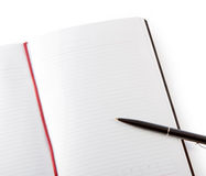 Open blank book with lines, red bookmark, black cover and pen. Stock Photos