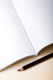Open blank book and pencil Stock Photography
