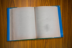Open blank book on wooden. Background Stock Images