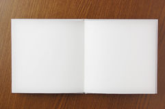 Open blank book on wooden table. Opened blank book Stock Photography