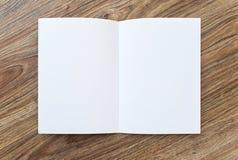 Open blank brochure, magazine is on a wooden desk Stock Photo