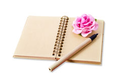 Open blank brown diary with pen and pink rose. Stock Photos