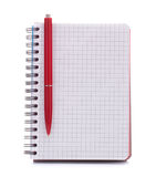 Open blank checked notebook with red pen Royalty Free Stock Image