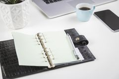 Open blank diary or personal planner on a desk Royalty Free Stock Photography