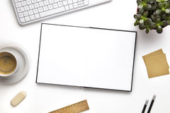 Open Blank Diary Surrounded With Office Supplies And Keyboard Stock Photography