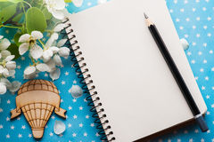 Open blank journal with flowers. On blue stars background. Flat lay top view style stock image