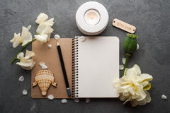 Open blank journal with flowers stock photo