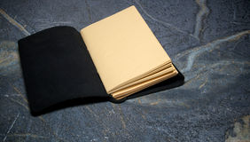 Open blank leather bound diary Stock Photos
