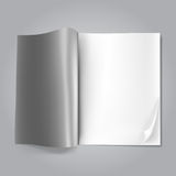 Open blank magazine. On grey Royalty Free Stock Photos
