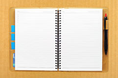 Open blank note book on cardboard Royalty Free Stock Image