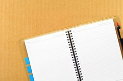 Open blank note book on cardboard Royalty Free Stock Photos