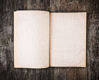 Open blank note book on old wood Royalty Free Stock Photos