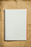 Open blank note book on wrapping paper Stock Photo