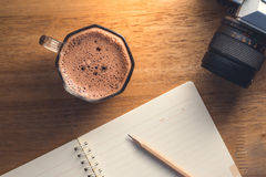 Open blank notebook with a cup of hot cocoa. Open blank notebook with a cup of hot cocoa Stock Image