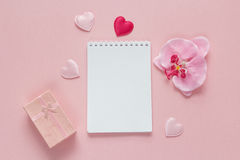 Open blank notebook with gift box, orchid flower and hearts on a Stock Photography