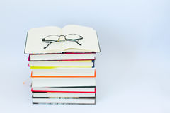 Open blank notebook with glasses and pencil on the top.  Royalty Free Stock Photography