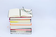 Open blank notebook with glasses and pencil on the top.  Royalty Free Stock Images