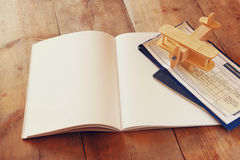 Open blank notebook over wooden table. ready for mockup. retro filtered image Royalty Free Stock Image