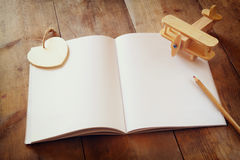 Open blank notebook over wooden table. ready for mockup. retro filtered image Stock Photography